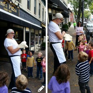 Man Showing Kids How to Make Pizza