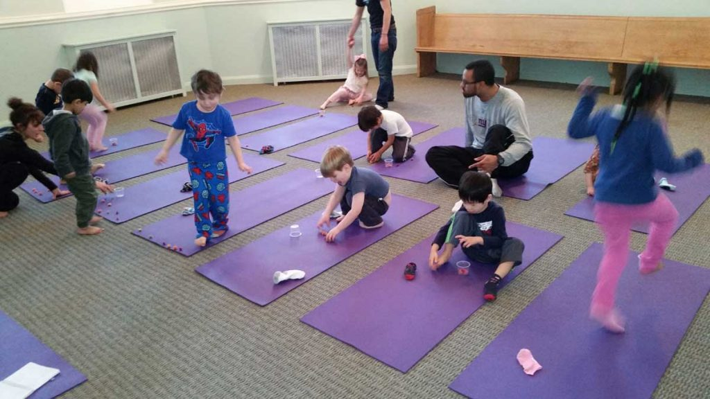 Kids on Mat Taking Yoga Class
