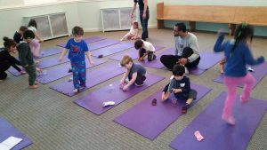 Kids on Mat Taking Yoga Class