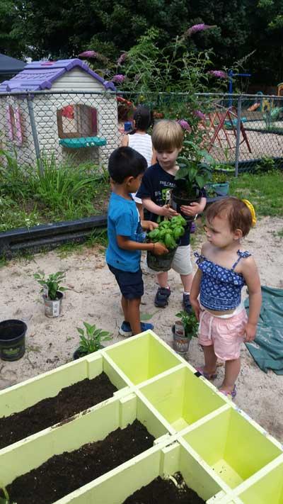 Kids Around Planter Boxes Ouside