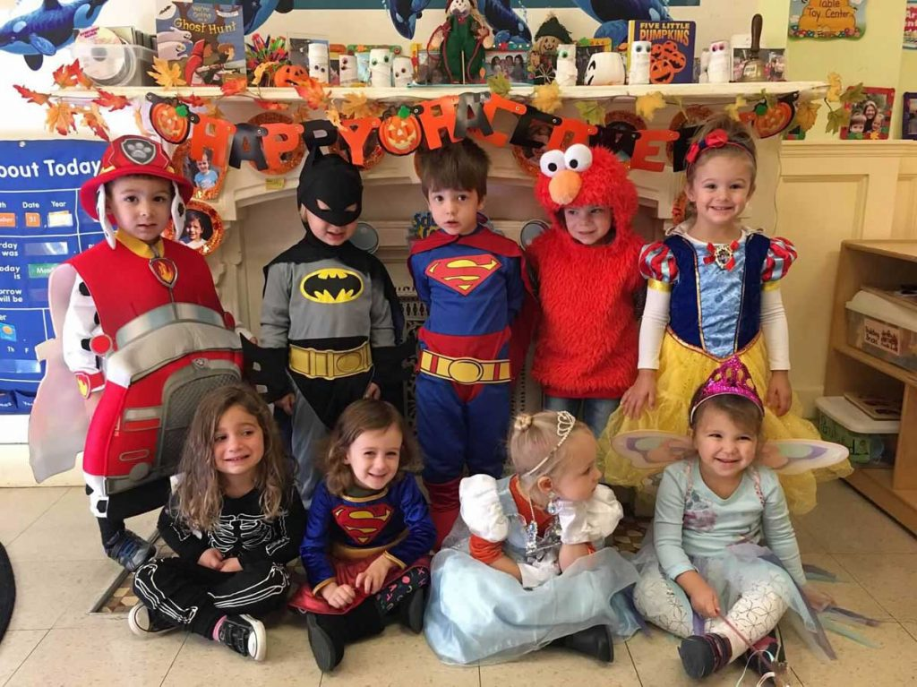 2 and 3 year old in Halloween costumes