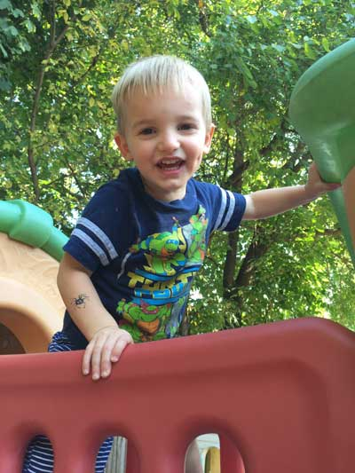 Boy playing on jungle gym