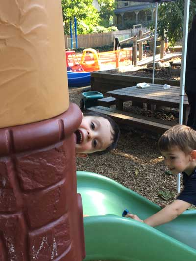 Two boys goofing around on playground
