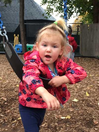 Girl on swing facing camera