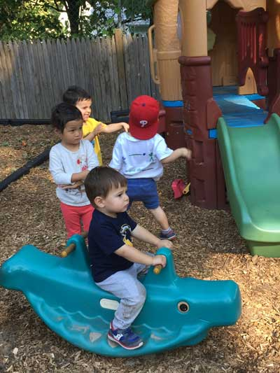 Kids playing outside in playground